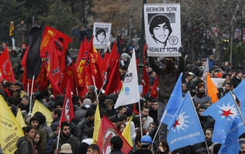 A demonstrator holds up a poster of Berkin Elvan during a protest in Ankara